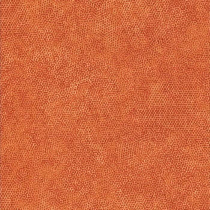 Oranje stof met honingraat motief.