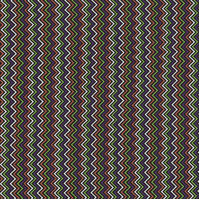 Halloween stof met zigzag motief in oranje,paars,groen,wit en zwart