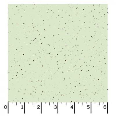 Licht groene stof met donker bruine stippen