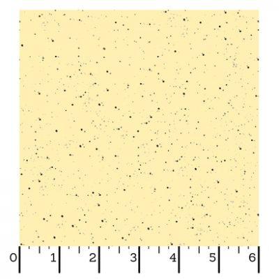Licht gele stof met donker bruine stippen