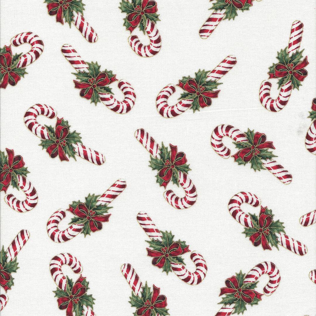 Ivoor kleurige stof met kerststokjes rood/groen/goud