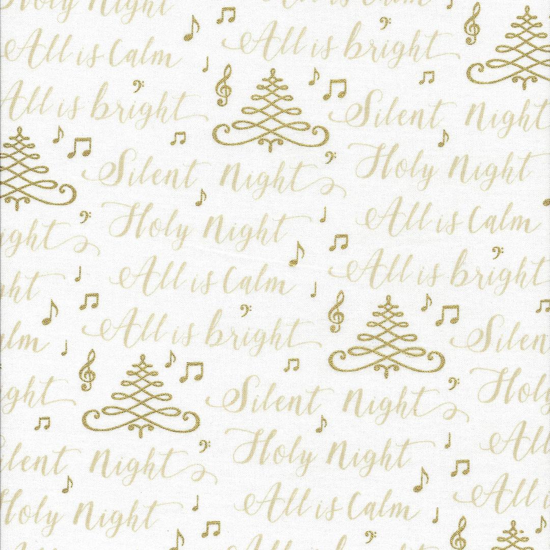 Ecru kleurige stof met tekst en  gouden kerstboompjes en muzieknoten