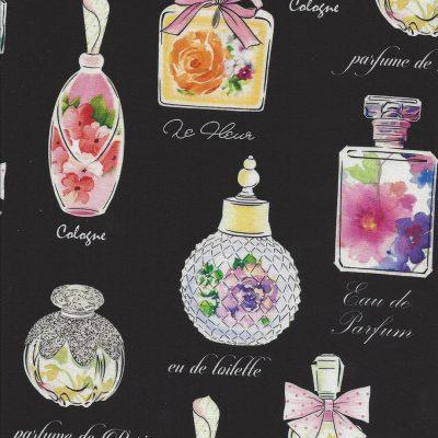 Zwarte stof met gekleurde parfumflesjes